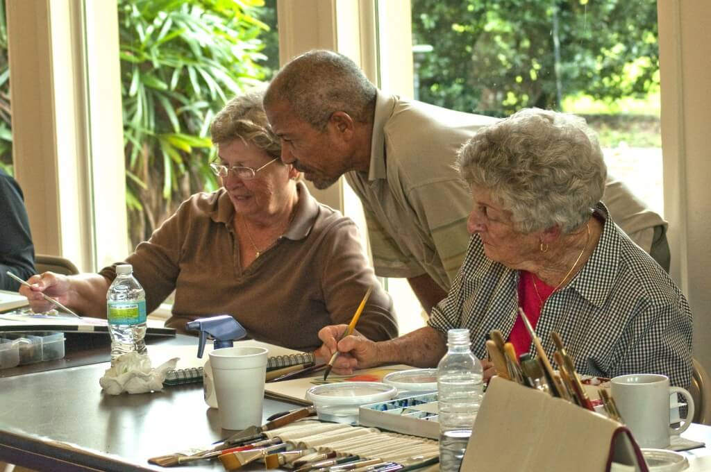 Owen Jolly works with students on basic and advanced watercolor techniques.