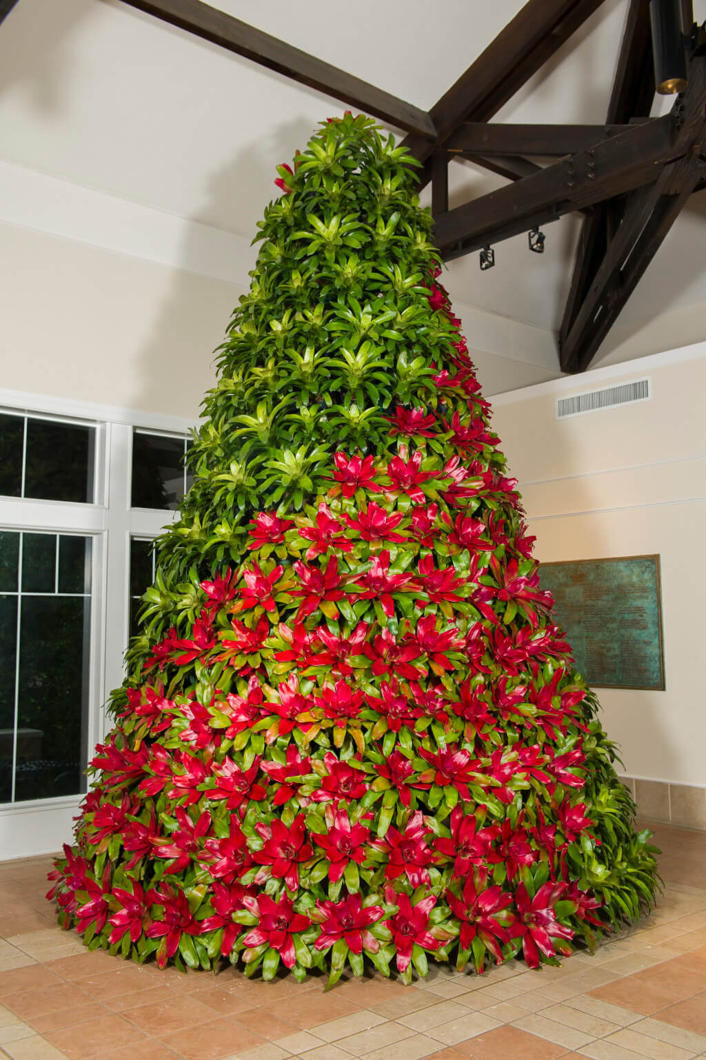 this new 15 foot tall christmas tree was created with nearly 400 bromeliads and can be seen in the visitor center during the christmas at bok tower gardens